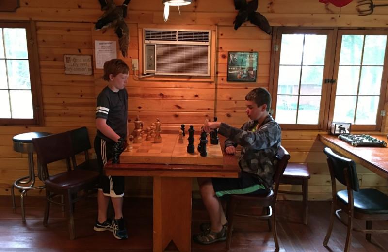 Kids playing chess at Cedar Point Resort.
