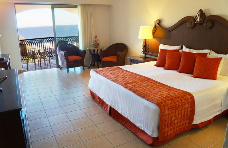 Guest room at Club Solaris All Inclusive Resort & Hotel Los Cabos.