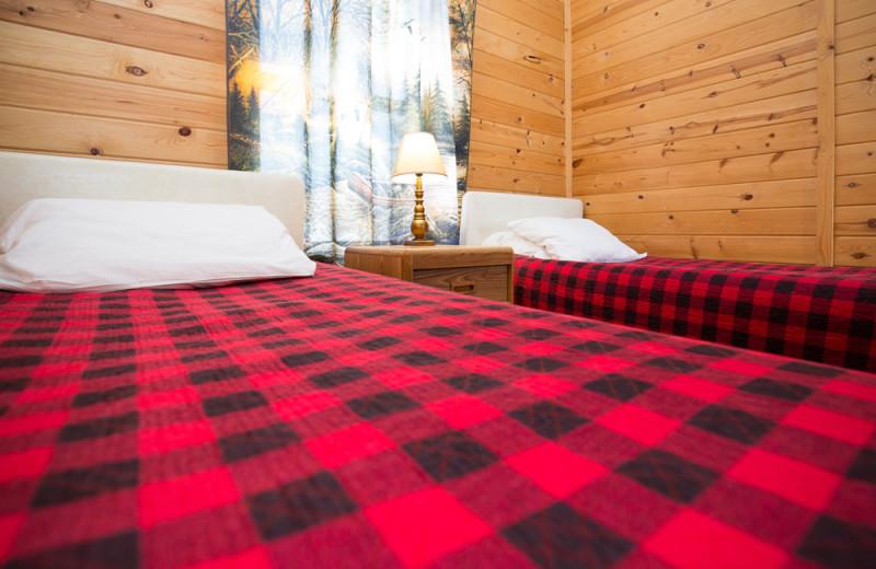 Guest cabin bedroom at River Bend's Resort & Walleye Inn.