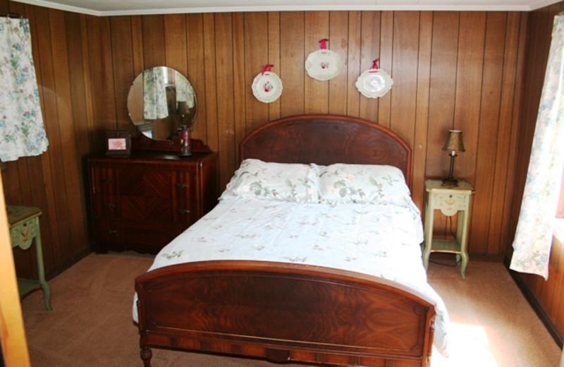 Cottage bedroom at Hemlock Campground & Cottages.