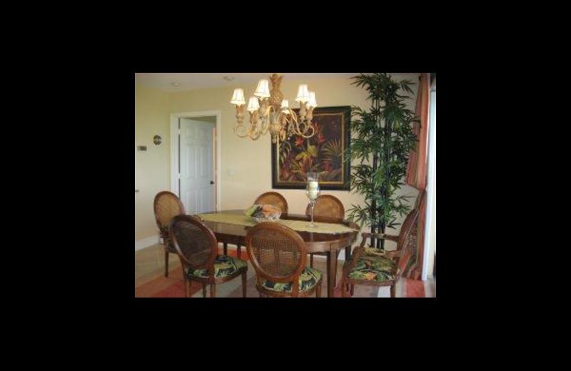 Vacation rental dining room at Sunshine Resort Rentals, LLC.
