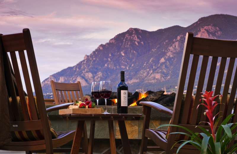 Enjoying a glass of wine by the fire pit on Mountain View Terrace at Cheyenne Mountain Resort.