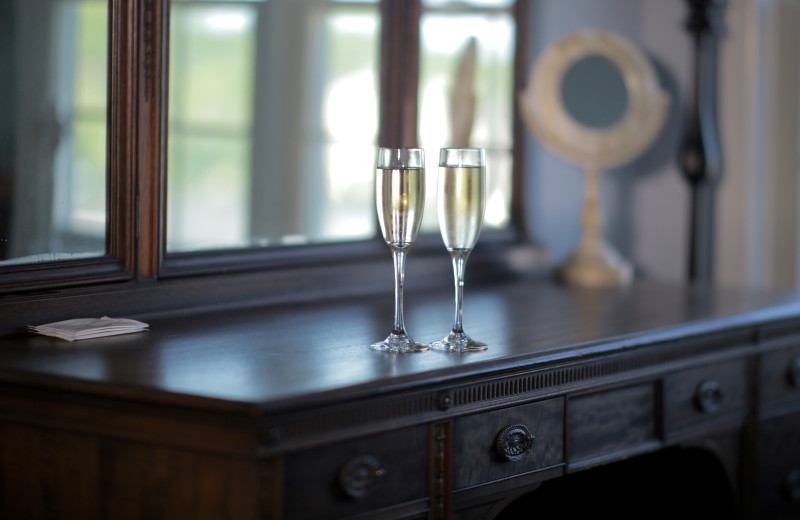 Dresser with two wine glasses at A Victorian On The Bay.