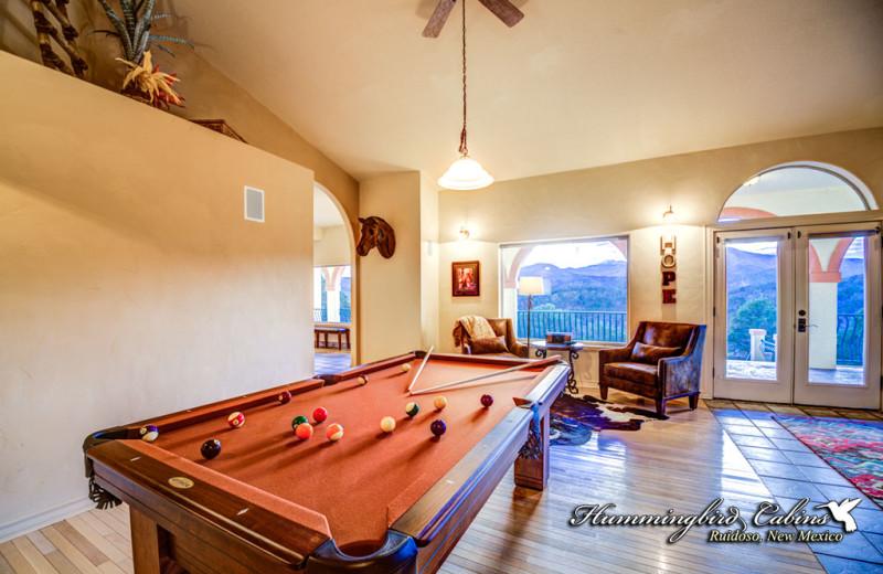Rental billiard table at Hummingbird Cabins.