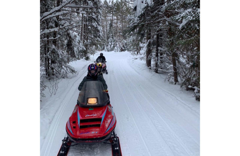 Snowmobiling at Timber Trails Resort.