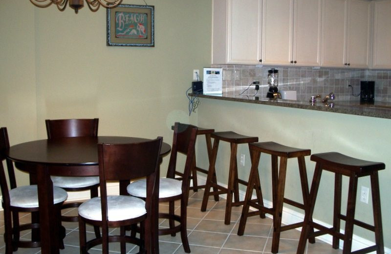 Rental kitchen and dining at Gulf Beach Rentals.
