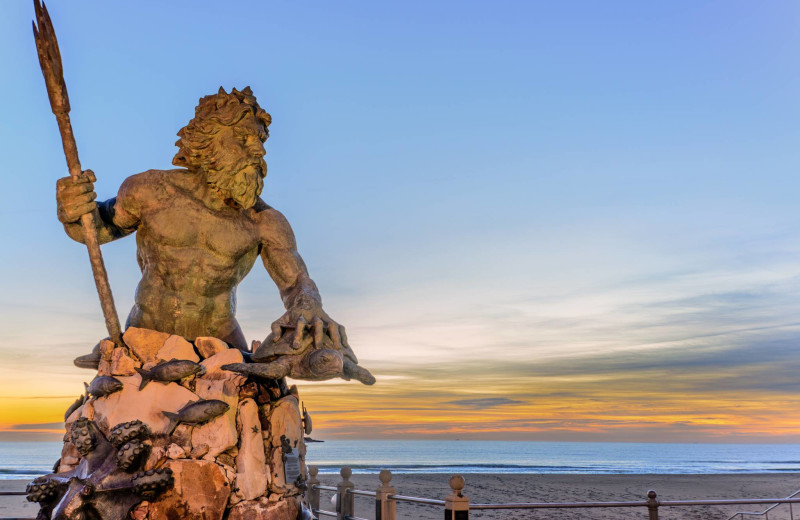 Neptune statue at Atkinson Realty.