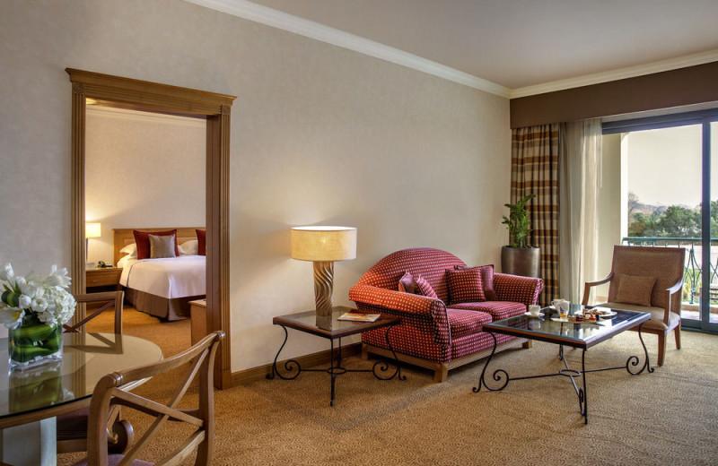 Guest room at Al Ain Rotana Hotel.