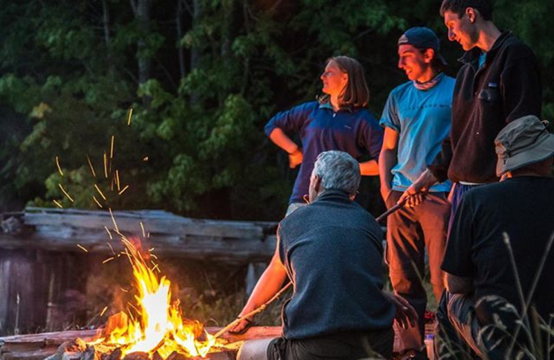 Group around the fire at Orca Camp.