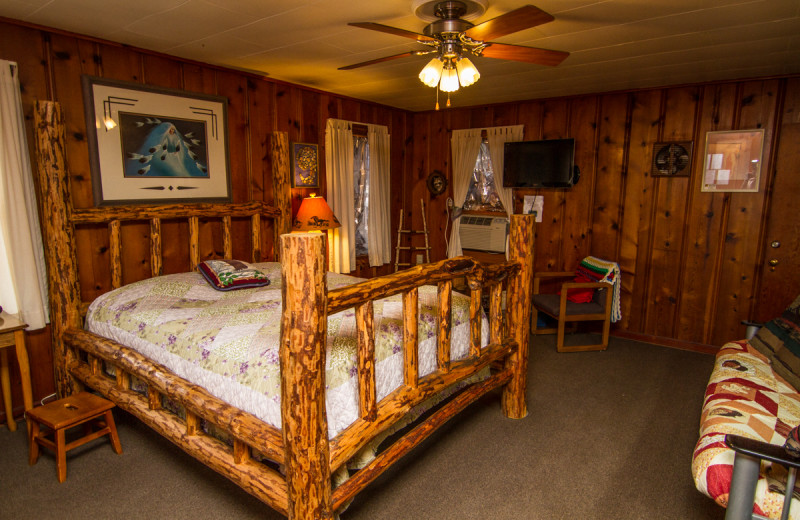 Cabin bedroom at Aunt Grace's Stay N Play Resort.