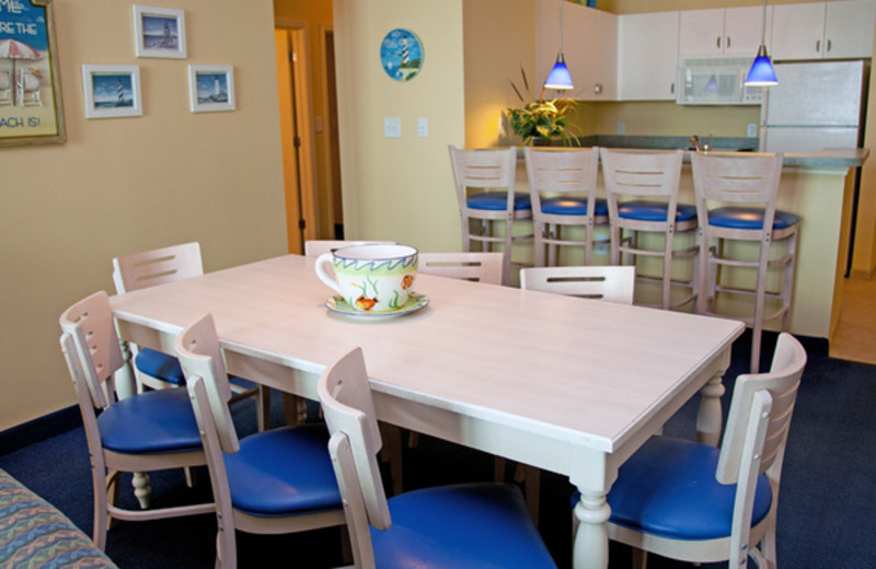 Guest dining table and kitchen at Avista Resort.