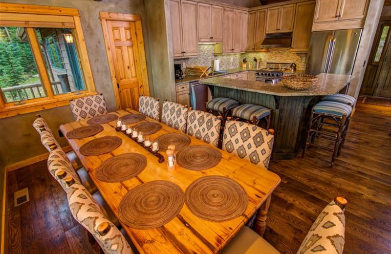 Rental kitchen and dining room at Black Diamond Vacation Rentals.