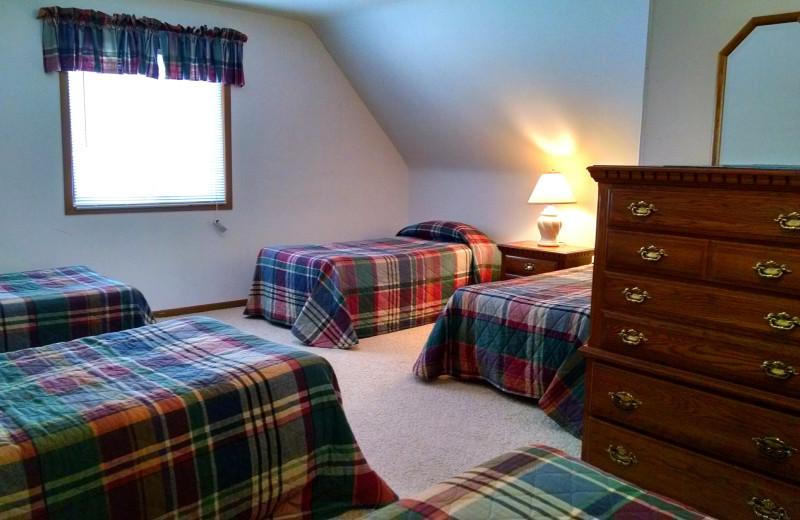Cabin bedroom at The Arrows Resort.