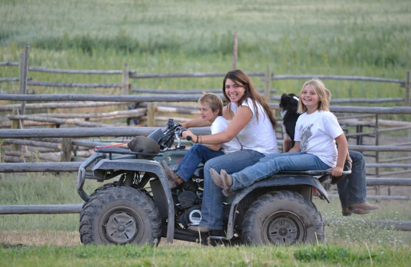 Family on ATV at Rocking Z Ranch.