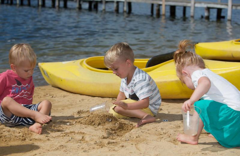Kids playing on beach at Naswa Resort.