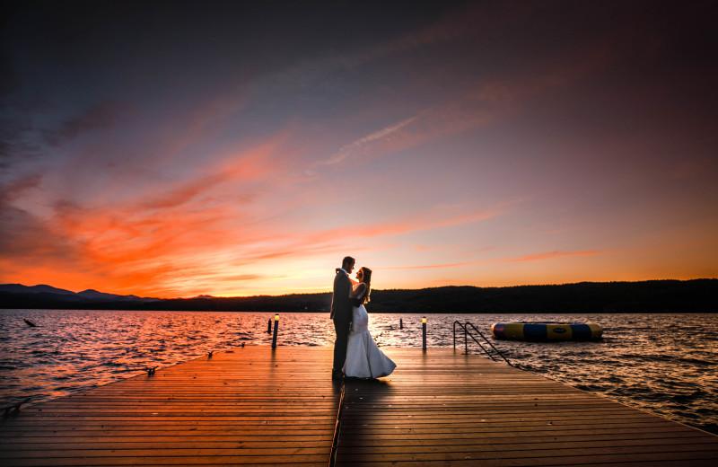 Sunset wedding dance on the swim dock - Photo by Sabin Gratz