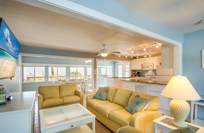 Rental living room at Sun Palace Vacation Rentals.