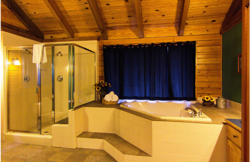 Cabin hot tub at Whispering Hills Cabins.