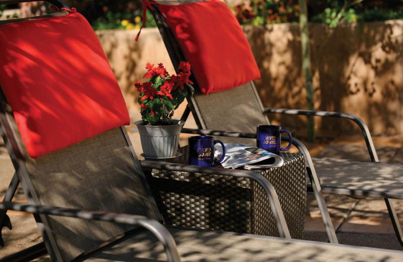 Pool chairs at Aspen Square Condominium Hotel.