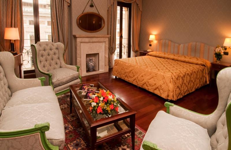 Guest room at Ambasciatori Palace Hotel.