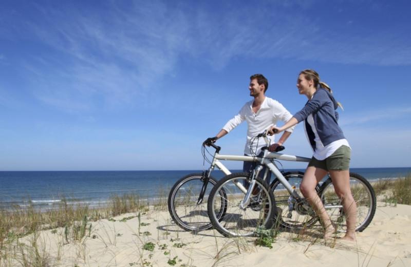 Biking on the beach at Shorepine Vacation Rentals.