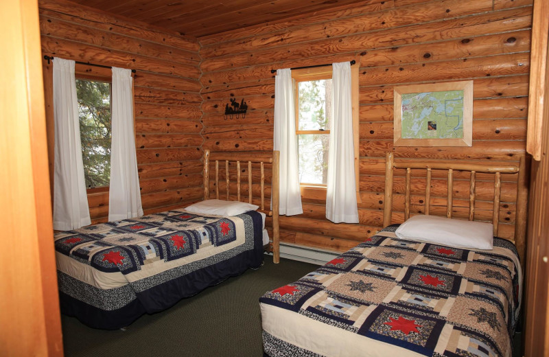 Cabin bedroom at Timber Trail Lodge & Resort.