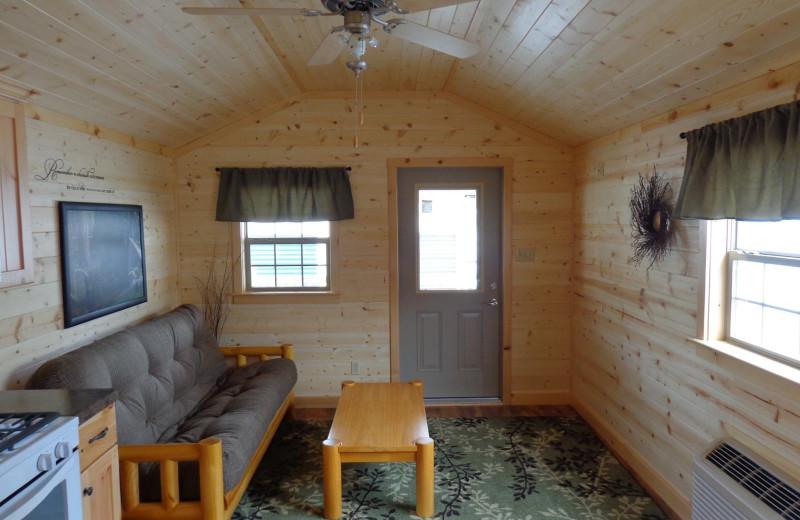 Cabin living room at Yogi Bear's Jellystone Park Gardiner.