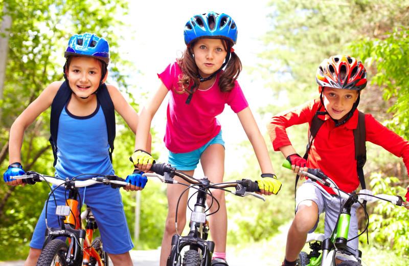 Kids biking at Driftwood Lodge Resort.