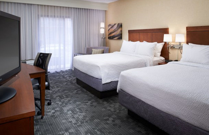Guest room at Courtyard by Marriott Detroit Dearborn.