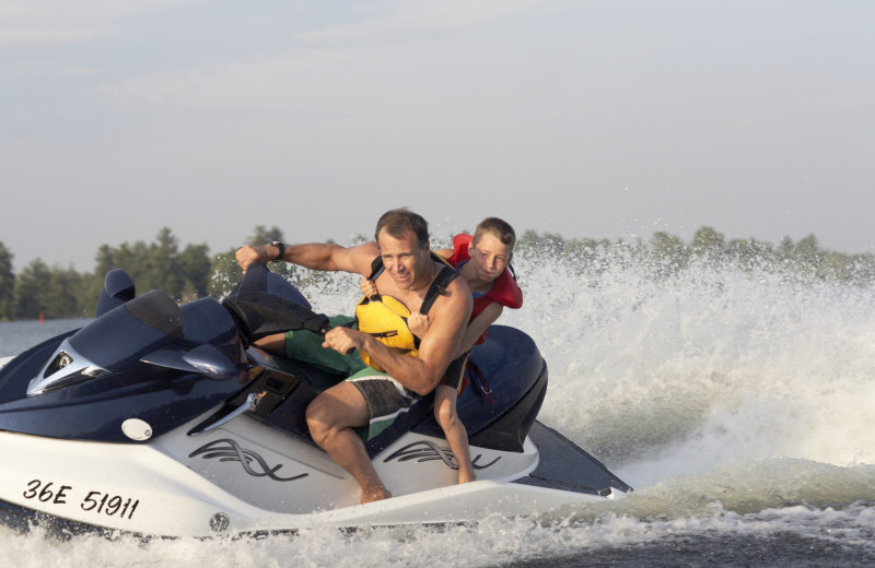 Family on jet ski at Holiday Inn Club Vacations at Orange Lake Resort.
