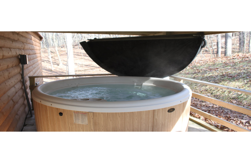 Cabin hot tub at Hocking Hills Backwoods Retreat.