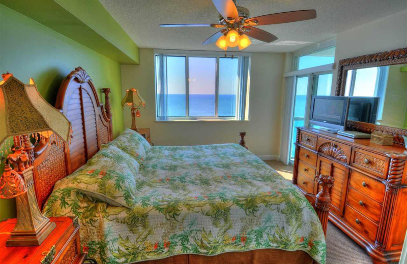 Rental bedroom at CondoLux Vacation Rentals.