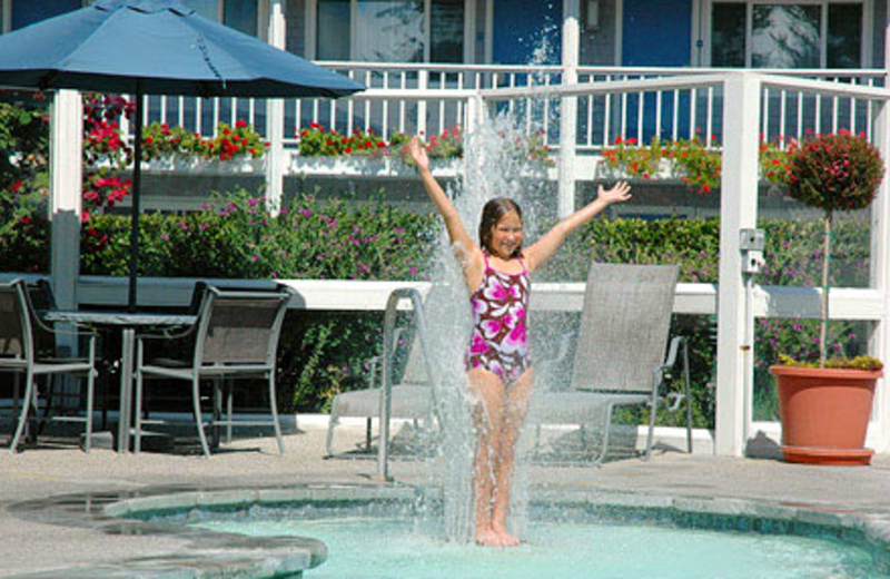 Kid Playing In Pool at Monterey Bay Lodge