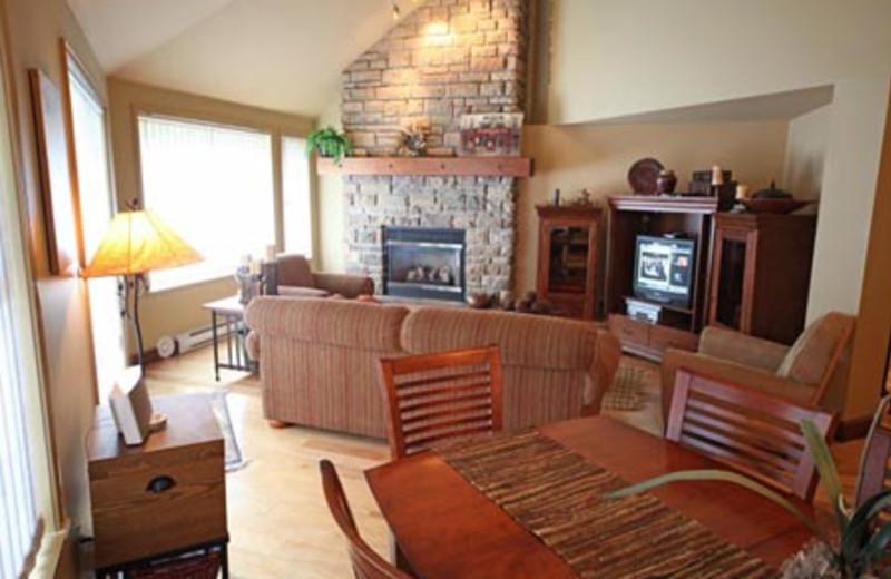 Rental living room at Acer Vacation Rentals Ltd.