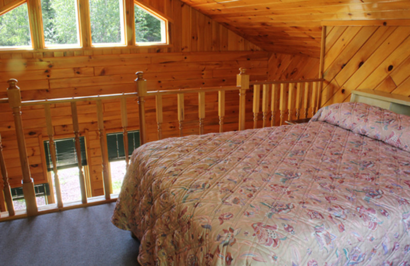 Cabin bedroom at Golden Eagle Lodge.