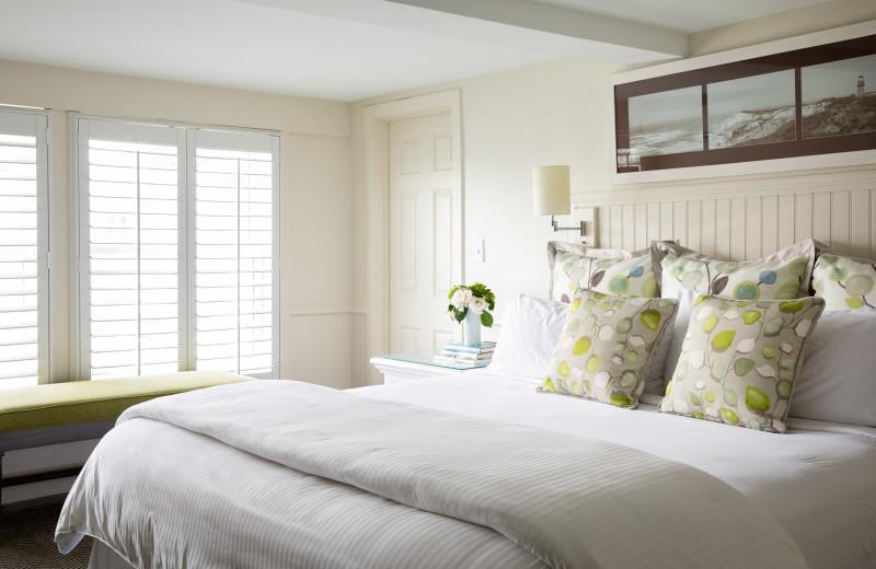 Guest bedroom at Vineyard Square Hotel & Suites.