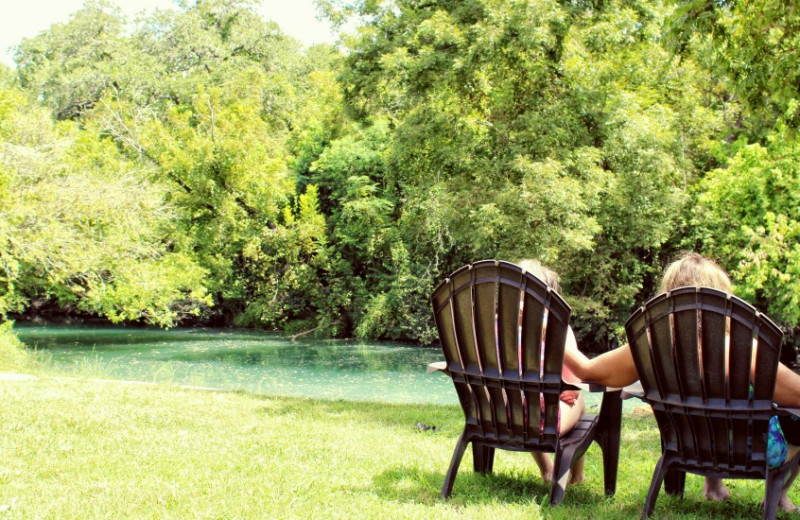 Relaxing by the water at Geronimo Creek Retreat.