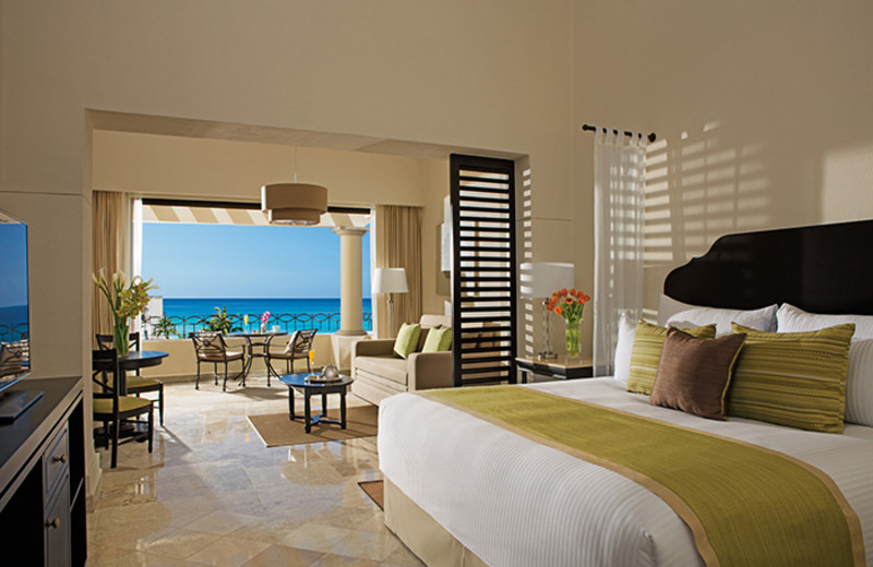 Guest room at Dreams Los Cabos Suites Golf Resort & Spa.
