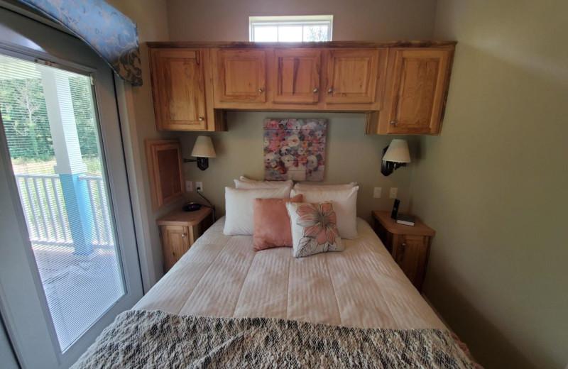 Cottage bedroom at Mill Creek Ranch Resort.