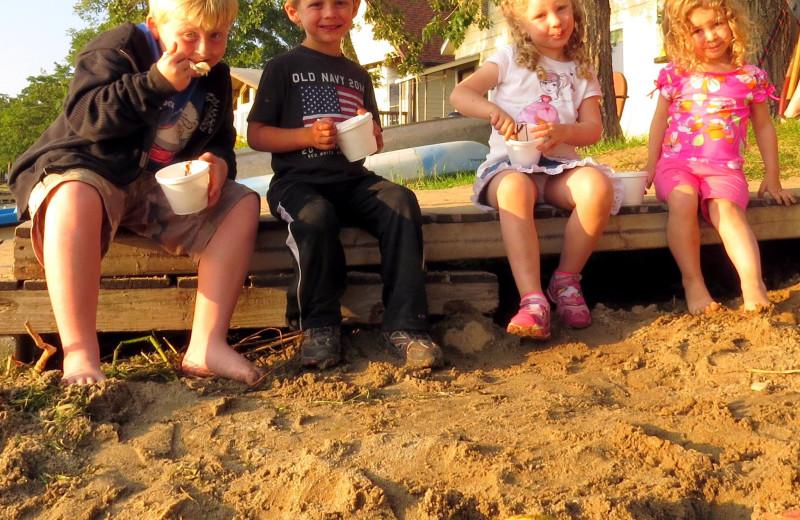 Kids on beach at Woodland Resort.