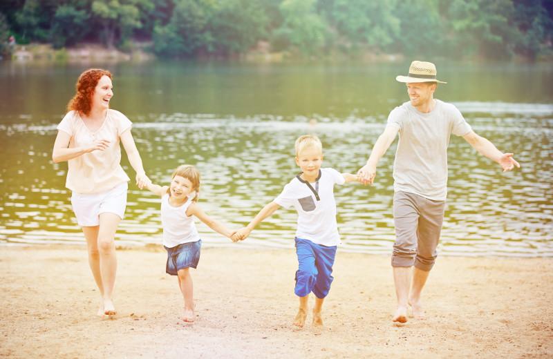 Family on beach at Glidden Lodge Beach Resort.