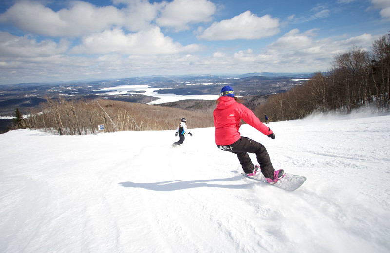 Snowboarding near Sunapee Harbor Cottages.