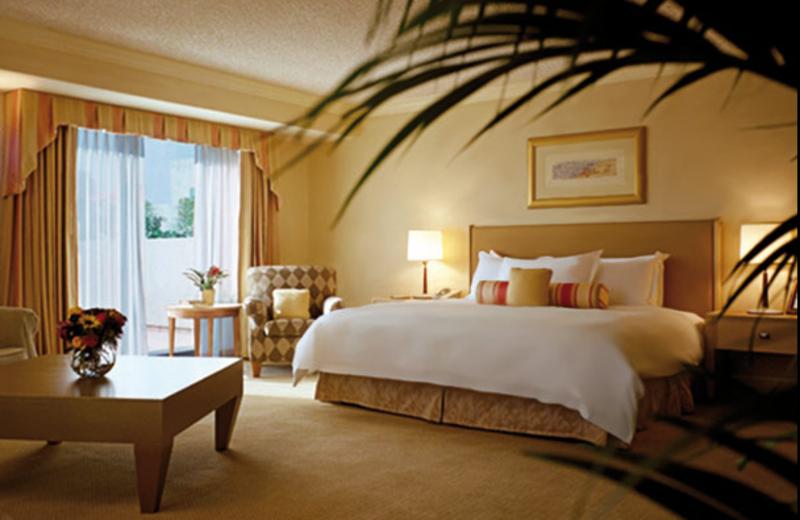 Guest room at Le Merigot Beach Hotel & Spa.