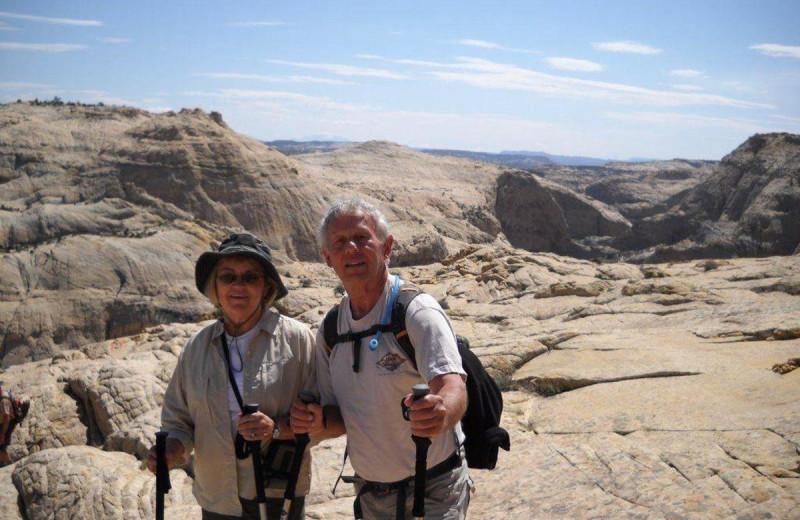Couple hiking near Chateau Aprés Lodge.