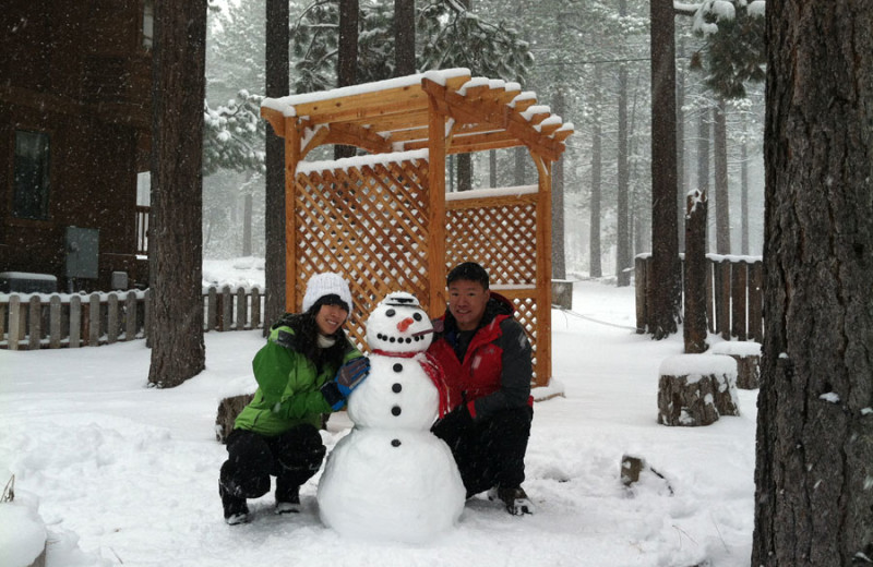 Family and snowman at Heavenly Valley Lodge.