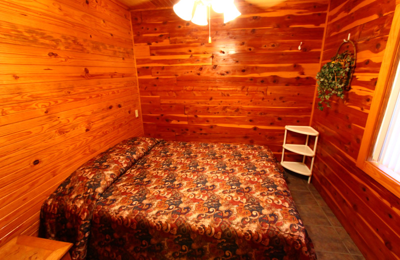 Cozy bedroom at Ozark Cabins.