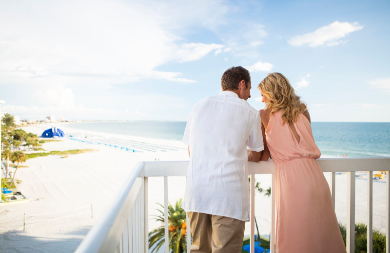 Couple on balcony at TradeWinds Island Grand.