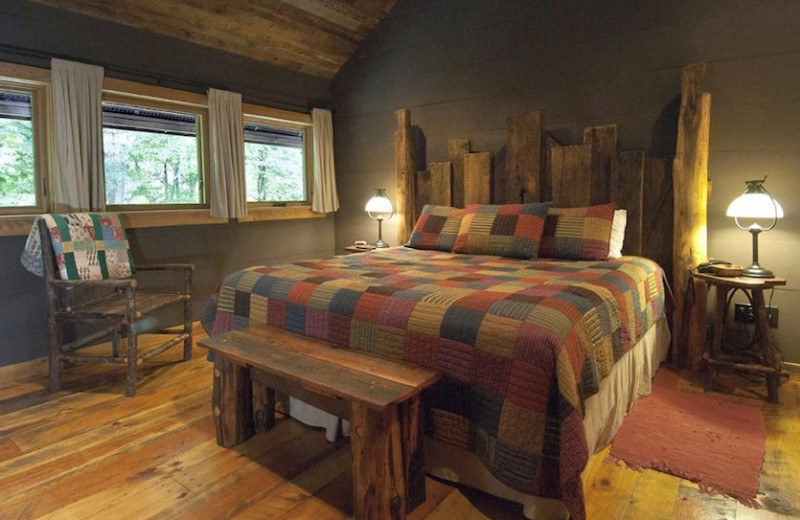 Master Bedroom at Nantahala River Lodge. Bed made from reclaimed wood from our Family Farm.