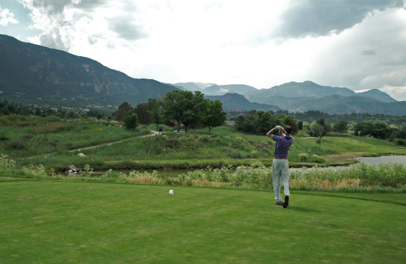 The 18-hole championship golf course at Cheyenne Mountain Resort features a rugged mountain ridge line backdrop and a private 35-acre lake.