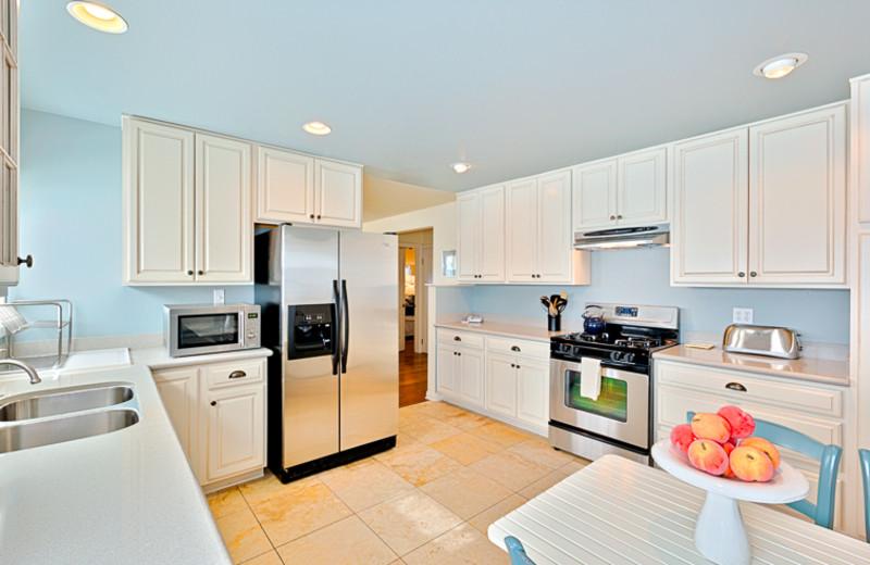 Vacation rental kitchen at Seabreeze Vacation Rentals, LLC.